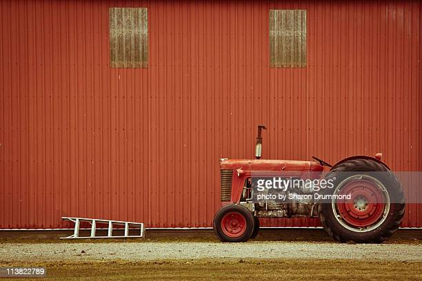 tractor and ladder beside barn - barn stock pictures, royalty-free photos & images