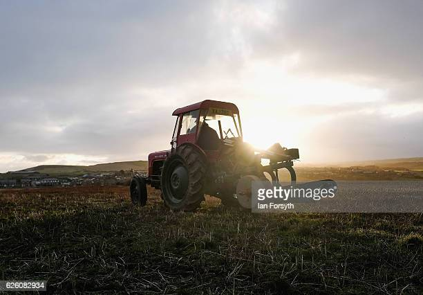 Tractor and plough are driven across a field to the registration point ahead of the annual ploughing match on November 27, 2016 in Staithes, United...