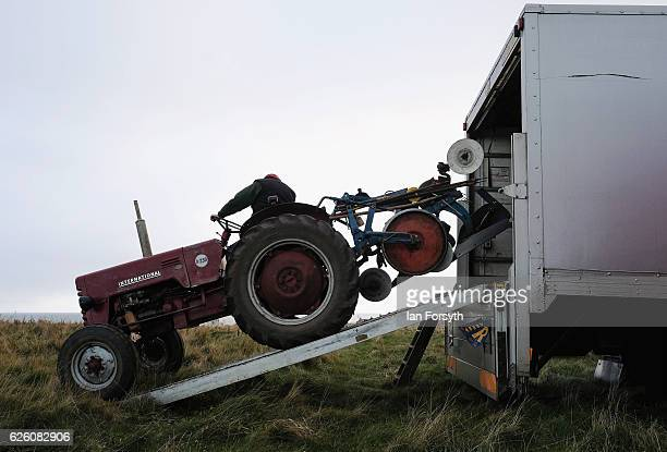 Tractor and plough are unloaded from a lorry ahead of the annual ploughing match on November 27, 2016 in Staithes, United Kingdom. The event which is...