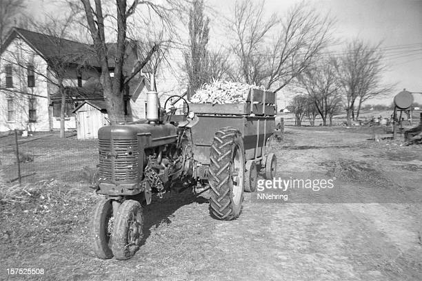 tractor and wagon with corn harvest 1957, retro