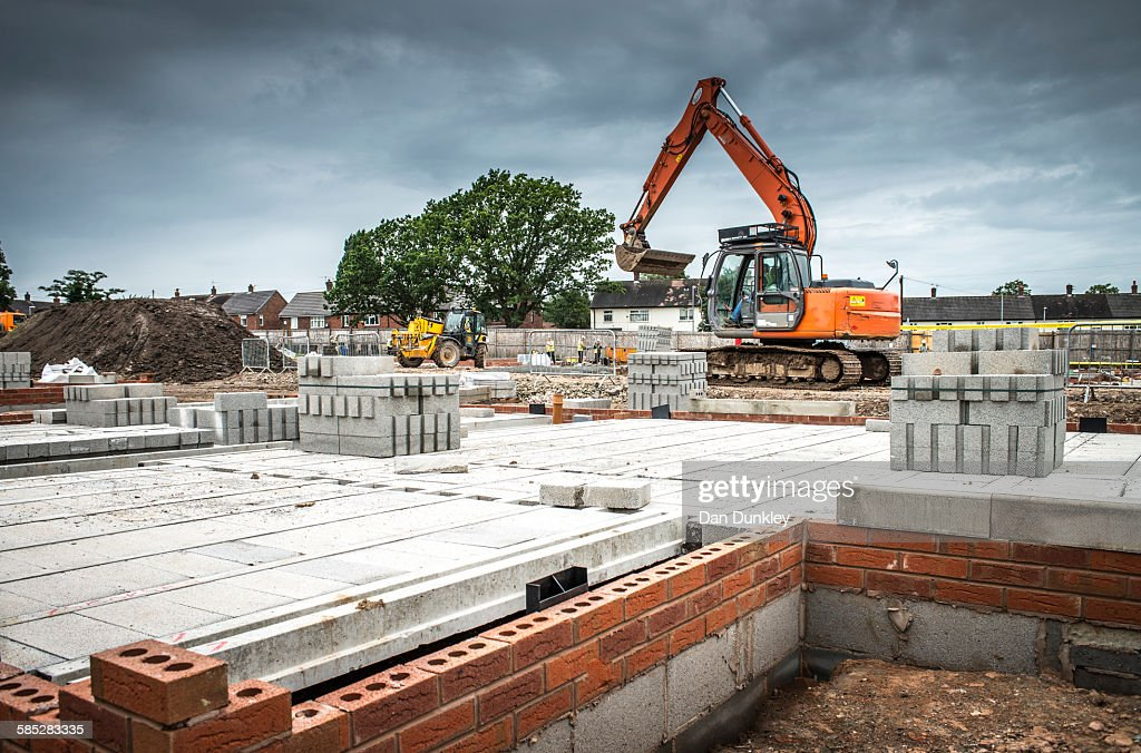 Tractor, building materials on construction site : Stock Photo