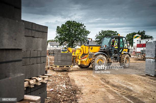 Tractor, building materials on construction site