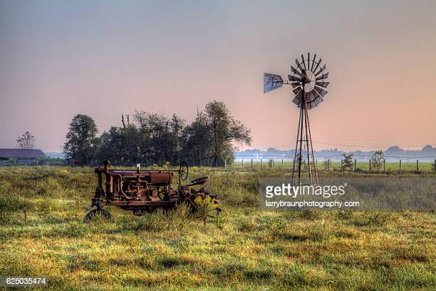 Tractor by a Windmill