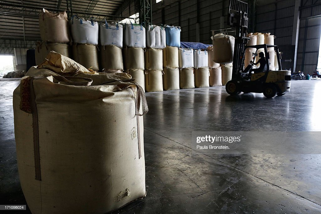 A tractor carries a huge bag of rice to the storage area inside a rice mill warehouse at the Settapanich -Samchuk rice mill in on June 20, 2013 in Suphan Buri, Thailand. Thailand plans to sell as much as 7 million metric tons from inventories in order to fund a grain purchase program. Recently financial sources revealed that the actual losses from the government's controversial rice pledging scheme for the 2011-12 rice harvest year are close to reaching 200 billion baht [US$6.5 billion], this is far above the Thai Finance Ministry's earlier forecast of 70-100 billion baht.