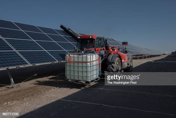 CALAMA CHILE MARCH 9 A tractor cleans the photovoltaic panels of Finis Terrae solar park which accumulates big amounts of dust due to the hard wind...