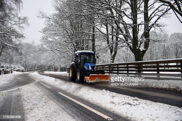 Tractor clears snow from the roads at Gleneagles golf course in Gleneagles as heavy snow fell on parts of Scotland on January 14, 2021.