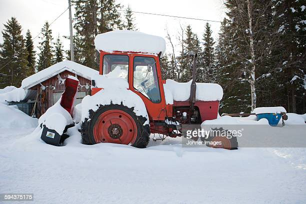 Tractor covered in snow