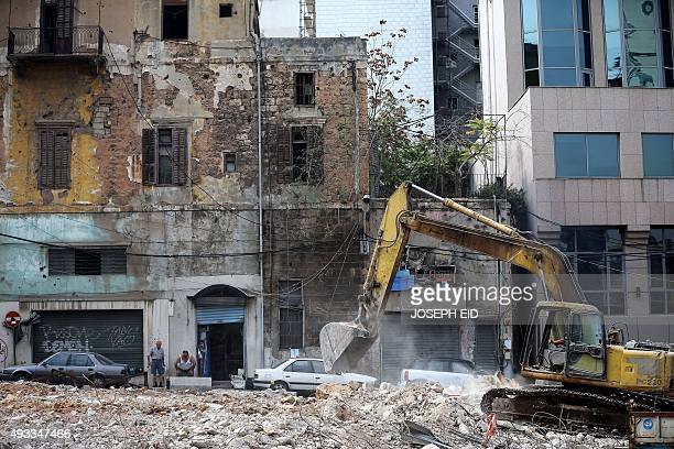 A tractor demolishes an old building at the place where a new one will be built in Beirut on October 19 2015 Conservationists are rushing to save...