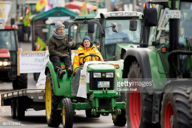 Tractor driver attend a march to demonstrate against the agroindustry on January 20 2018 in Berlin Germany Marchers whose protest is coinciding with...