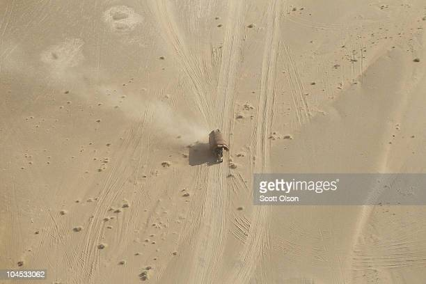 Tractor drives across the vast desert September 29, 2010 near Marja, Afghanistan. U.S., coalition, and Afghani troops continue to suffer losses in...