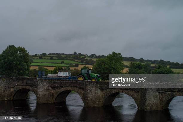 Tractor drives over a bridge over the River Finn, that forms the border between Northern Ireland and Ireland on August 30, 2019 in Clady, Northern...