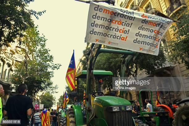 A tractor holding a banner writting on it 'democracy' is seen in the middle of the street during a protest Around 400 tractors called by agricultural...