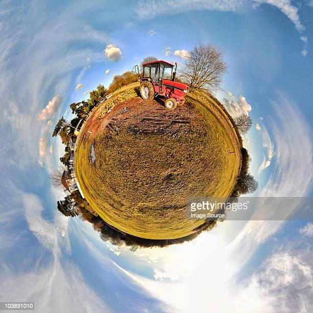 tractor in field with little planet effect - fish eye foto e immagini stock
