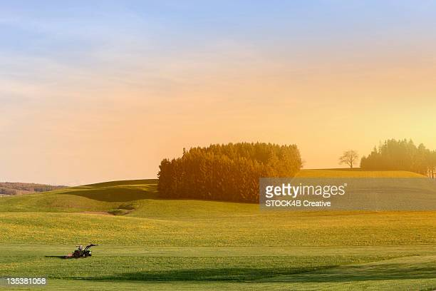 Tractor in rolling landscape, Bavaria, Germany