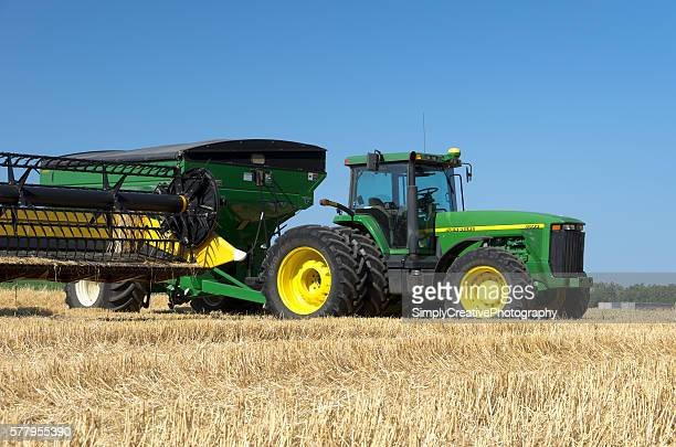 tractor in wheat field - john deere stock pictures, royalty-free photos & images