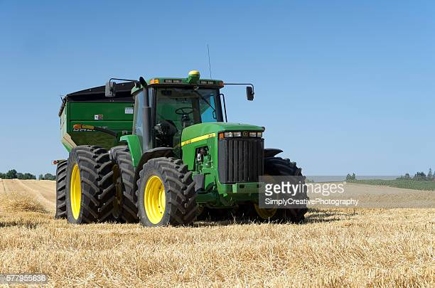 tractor in wheat field - tractor stock pictures, royalty-free photos & images