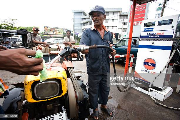 A tractor is filled up with petrol at an Indian Oil Co petrol station in Colombo Sri Lanka on Monday Sept 24 2007 Ceylon Petroleum Corp Sri Lanka's...