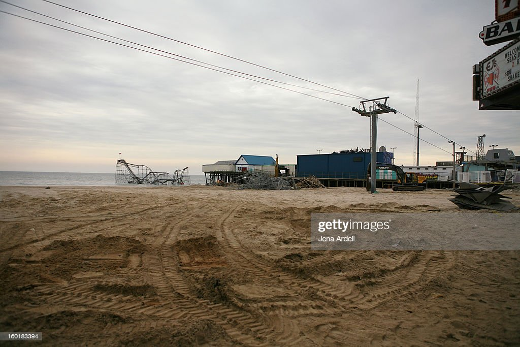 CONTENT] Tractor marks in the sand where the Seaside Heights boardwalk once stood, post Hurricane Sandy, with view of the Jet Star roller coaster, the famous skyride featured on Jersey Shore, and remnants of the Funtown pier. (This is toward the northern end, looking southward).