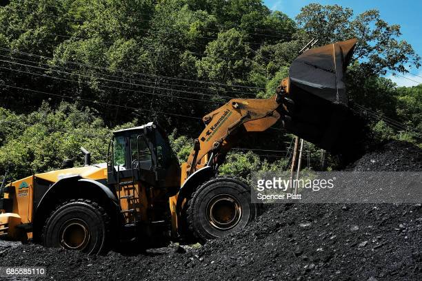 A tractor moves coal at a coal prep plant outside the city of Welch in rural West Virginia on May 19 2017 in Welch West Virginia West Virginia a...