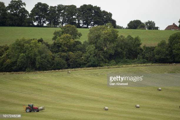 A tractor moves grass bales on August 15 2018 in Cudham England The National Farmers' Union has warned that Britain would 'run out of food' next year...