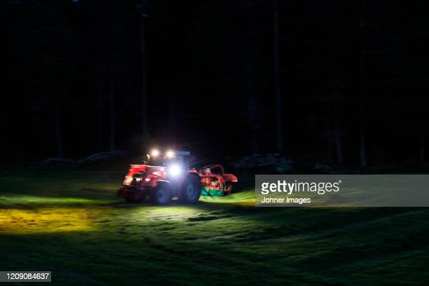 tractor mowing grass - tractor stock pictures, royalty-free photos & images