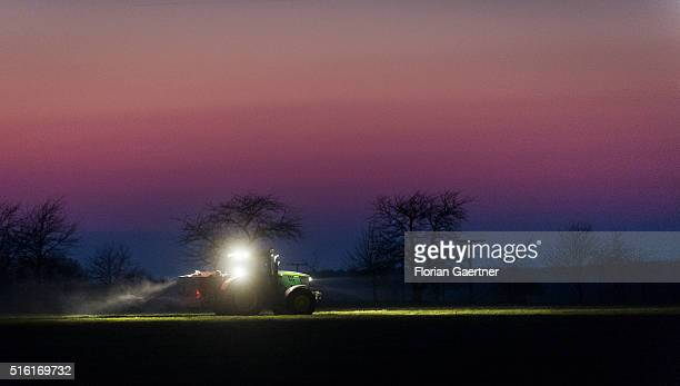A tractor on field during evening light on March 17 2016 in Foerstgen Germany