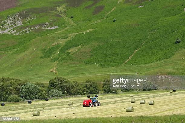 Tractor On Grassy Landscape