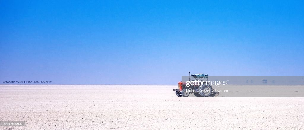 Tractor On Landscape Against Sky : Stock Photo