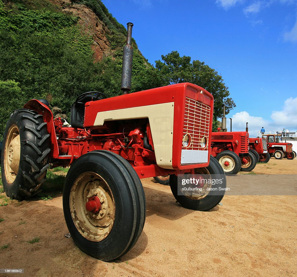Tractor on sand : Stock Photo