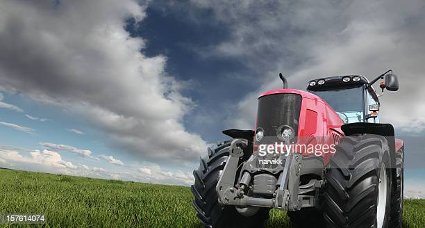 Tractor on the Green Field