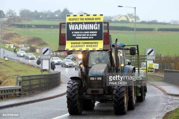 A tractor participates in a go slow protest at the border crossing in Killeen near Dundalk to protest against the potential introduction of border...
