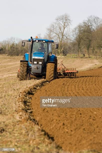 Tractor ploughing field in Oxfordshire The Cotswolds United Kingdom