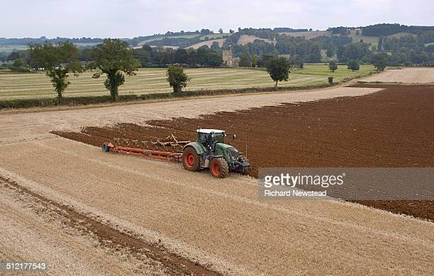 tractor ploughing field - 耕す ストックフォトと画像