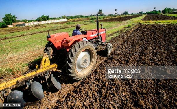 A tractor ploughs an agricultural field in the Sudanese capital Khartoum's district of Jureif Gharb on November 11 2019 The Blue Nile is a renegade...