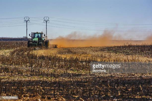 A tractor ploughs ground through a harvested corn field on the Ehlerskroon farm outside Delmas in the Mpumalanga province South Africa on Thursday...