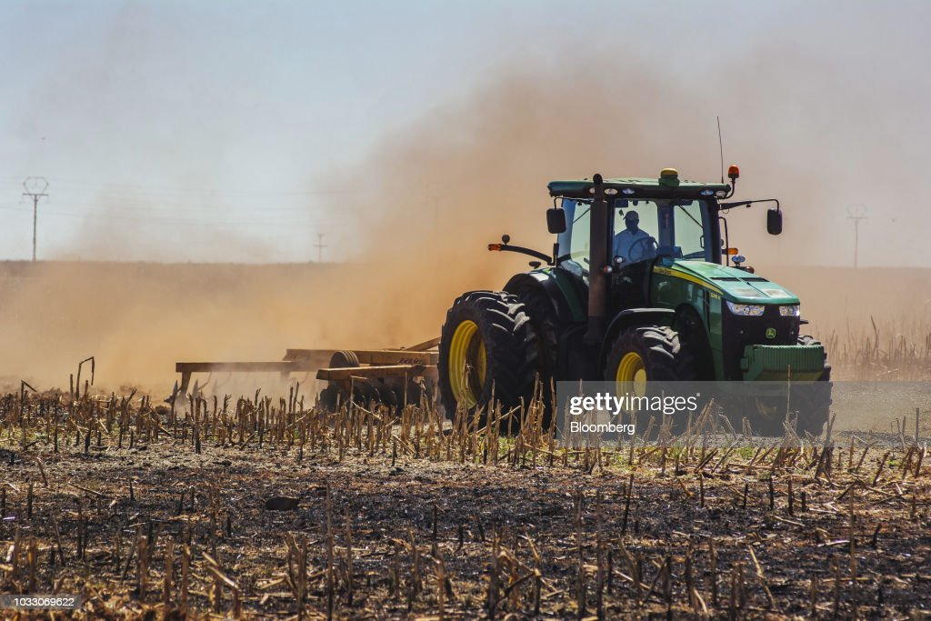 A tractor ploughs ground through a harvested corn field on the Ehlerskroon farm, outside Delmas in the Mpumalanga province, South Africa on Thursday, Sept. 13, 2018. A legal battle may be looming over plans by South Africas ruling party to change the constitution to make it easier to expropriate land without paying for it, with widely divergent views over the process that needs to be followed. Photographer: Waldo Swiegers/Bloomberg via Getty Images