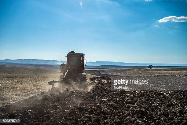 Tractor plows land at the Nikitin kolkhoz near Ivanovka village Azerbaijan Ivanovka is a village with mainly Russian population which maintained last...