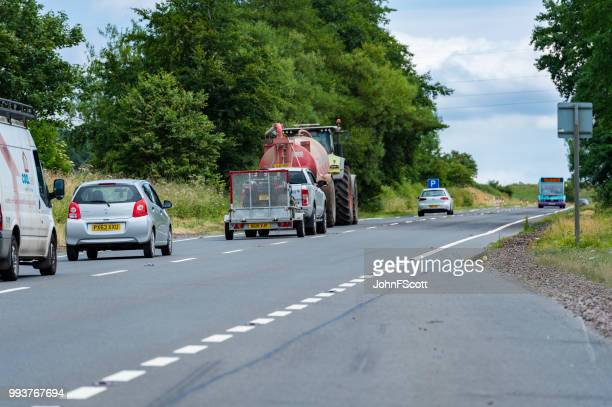 Tractor pulling a trailer on a main Scottish road