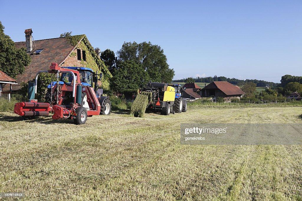 Tractor Pulling Hay Baler Switzerland Vaud Summer Evening