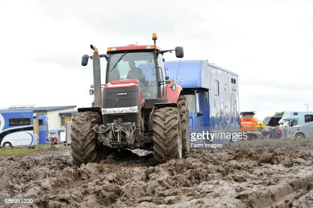 Tractor pulling horsebox out of the muddy car park at the Yorkshire Show 2012 which was cancelled due to bad weather