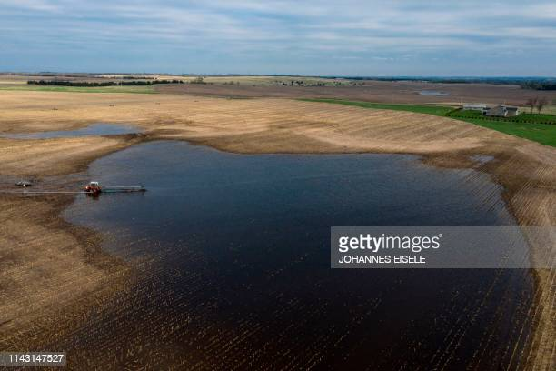 A tractor pumps water from a flooded field near Orchard Antelope County Nebraska on May 5 2019
