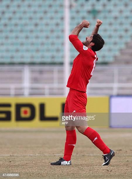 Tractor Sazi Tabriz's Karim Ansarifard celebrates after scoring against Saudi Arabia's AlIttihad club during their Champions League Group C football...