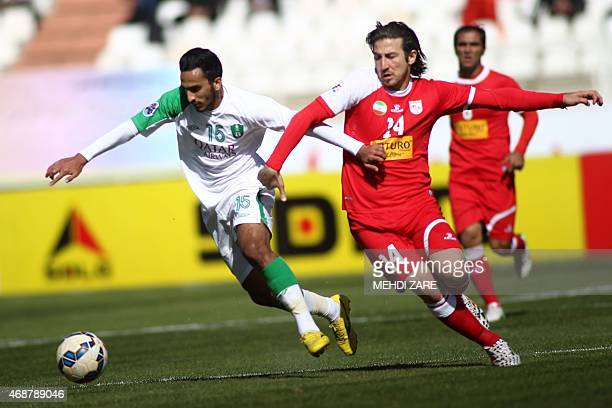 Tractor Sazi's Andranik Taymourian fights for the ball with AlAhli's Saleh Mohammad Aljaman during their AFC champions league Group D football match...