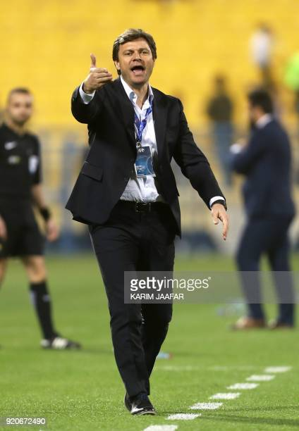 Tractor Sazi's coach Ertugrul Saglam reacts on the sidelines during the AFC Champions League Group A football match between Qatar's AlGharafa and...