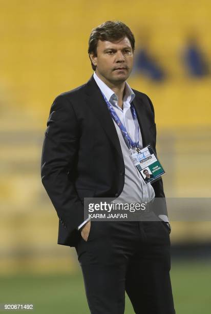 Tractor Sazi's coach Ertugrul Saglam watches from the sidelines during the AFC Champions League Group A football match between Qatar's AlGharafa and...