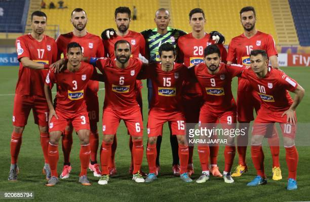 Tractor Sazi's first eleven pose for a team photo prior to the start of the AFC Champions League Group A football match between Qatar's AlGharafa and...