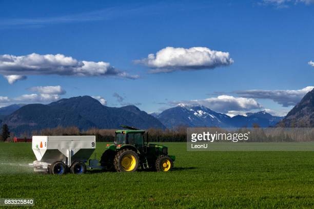 tractor spraying fertilizer in field at fraser valley, bc, canada - istock stock pictures, royalty-free photos & images