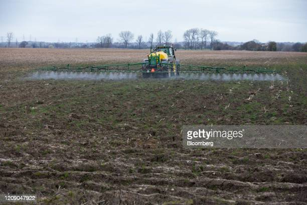 A tractor sprays crops in a field in Danbury UK on Monday March 30 2020 The UK could tighten its lockdown measures if more action is necessary...