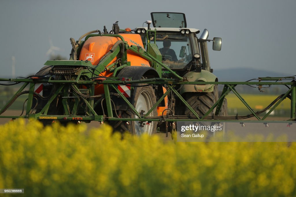 Tractor Sprays Pesticide : News Photo