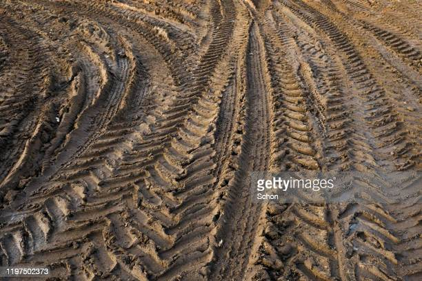 tractor track in brown clay - wheel stock pictures, royalty-free photos & images